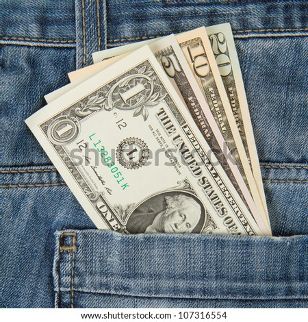 Macro shot of trendy jeans with american four different dollar bills on its pocket - stock photo