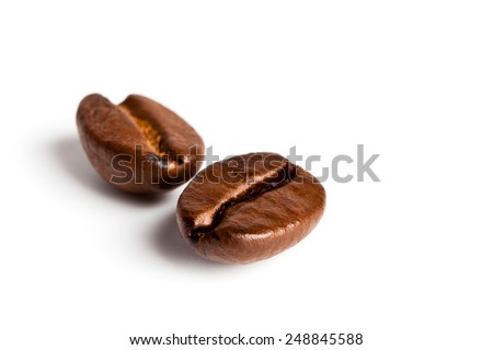 macro shot of two coffee beans isolated on white background - stock photo