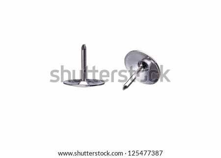 Macro Shot of two Drawing pins, isolated on white background