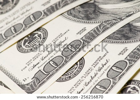 Macro shot of 100 US dollars. Shallow DOF - stock photo