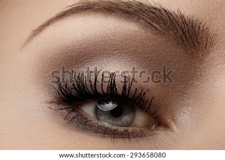 Macro shot of woman's beautiful eye with extremely long eyelashes. Sexy view, sensual look  - stock photo