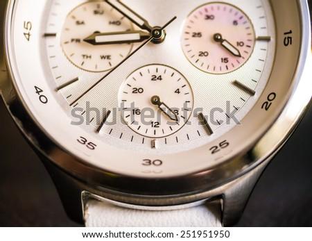 Macro shot of wrist watch processed in warm tone - stock photo