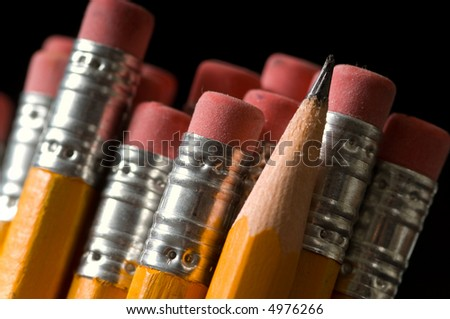 Macro shot of yellow pencils all erasers visible except one sharpened pencil, copy space to the left,