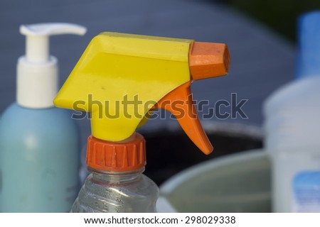 Macro shot of yellow vaporizer and other cleaning supplies in the blurred background - stock photo