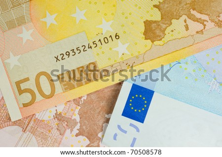 macro shot showing uro currency with the flag map and the fifty euro denomination