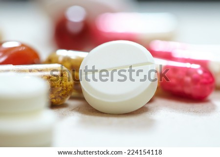 macro shots of tablets and capsules - stock photo