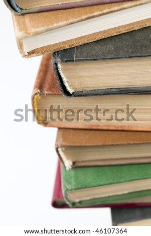 Macro shut of stack of colorful old books on white background, with clipping path included - stock photo