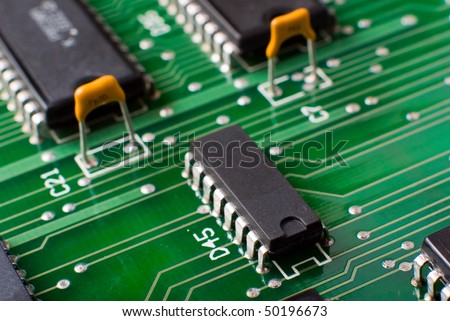 macro silicon chip on green board - stock photo