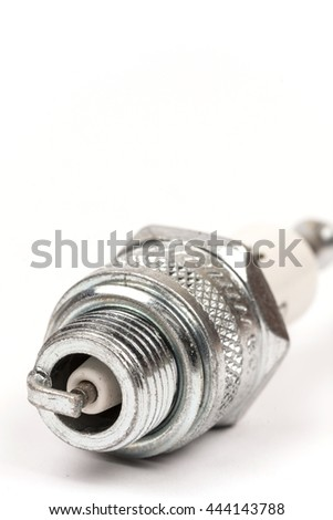 Macro spark plug copy space white background