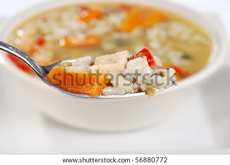 macro spoonful chicken and wild rice soup - stock photo