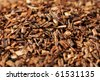Macro studio shot of dry antioxidant rich healthy herbal rooibos tea from the Western Cape region in South Africa. - stock photo