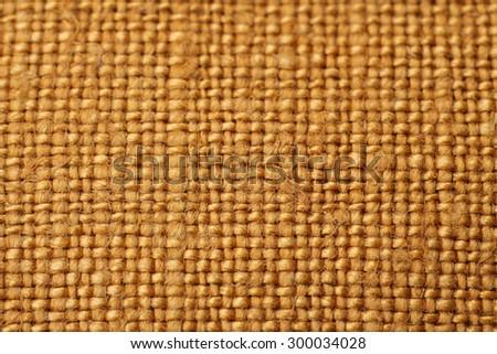 Macro textile orange and sun - stock photo