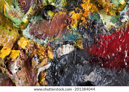 macro texture of colorful oil paints on an artist's palette