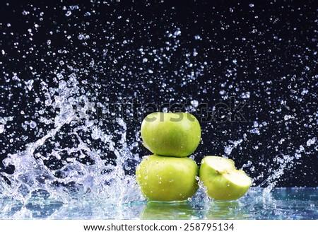 Macro three green apple in water drop stream - stock photo
