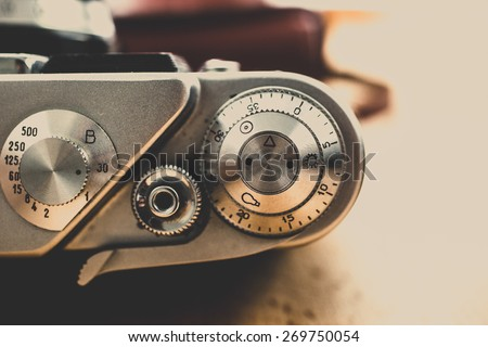 Macro toned shot of metal buttons and controls on vintage film camera - stock photo