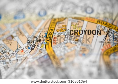 Macro view of a detailed London road map. (selective colouring) - stock photo