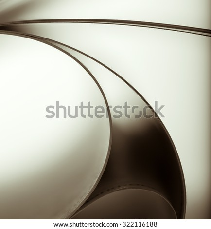 Macro view of abstract paper curves. Toned - stock photo