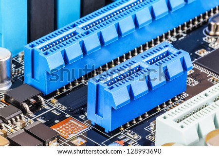 Macro view of blue PCI Express slots on computer motherboard - stock photo