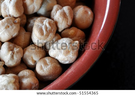 Macro view of chickpeas in a red bowl