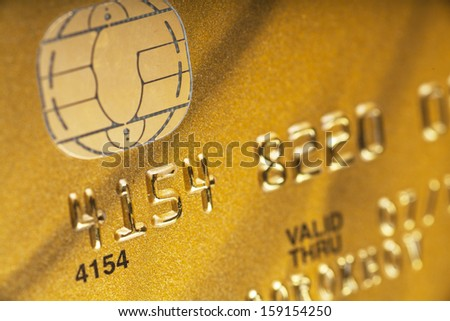 Macro view of golden credit card. Narrow focus. - stock photo