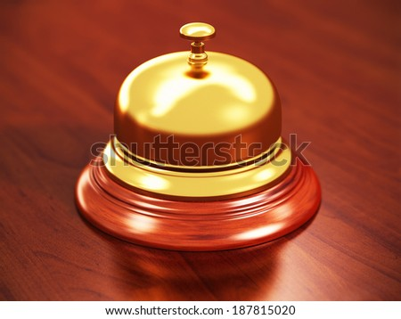 Macro view of hotel reception bell on wooden table with selective focus effect - stock photo