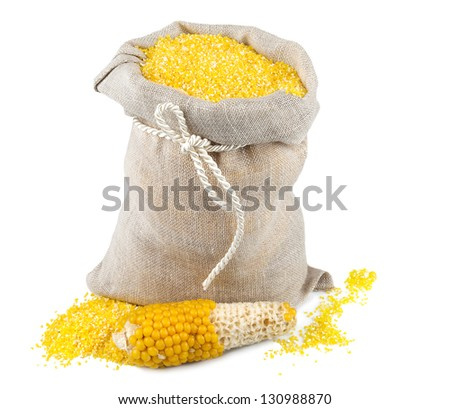Macro view of maize flour in flax sack with corncob isolated on white background - stock photo