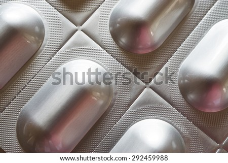 Macro view of one silver colored tablet blister pack
