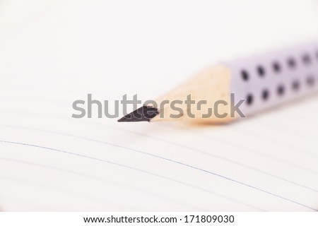 Macro view of pencil on a blank sheet - stock photo