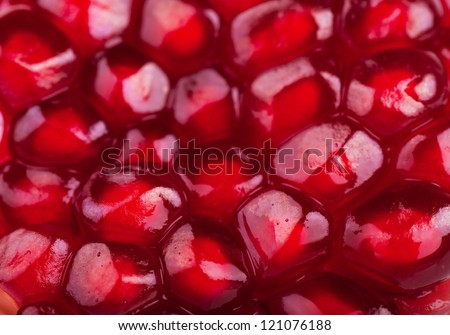 Macro view of ripe seeds of pomegranate - stock photo