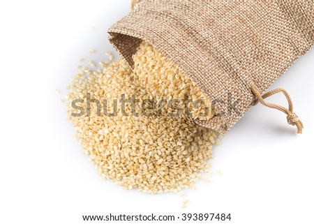 Macro view of sesame seeds in flax sack with tie isolated on white background - stock photo