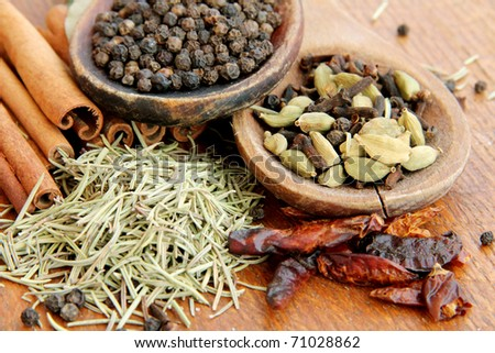 Macro view of the different spices on wooden background - stock photo