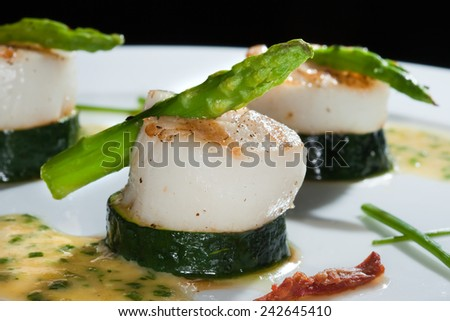 macro white dish with zucchini and asparagus beautifully decorated studio on dark background