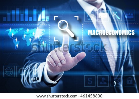 macroeconomics, business, technology and internet concept: businessman are using a virtual computer and are selecting macroeconomics.