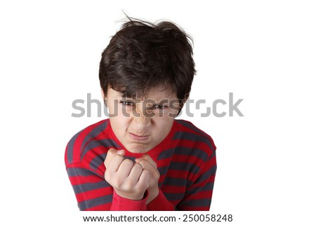 Mad angry boy with clenched fists on white isolated background - stock photo