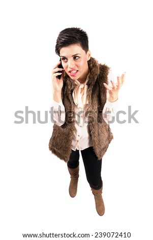 Mad angry woman on the phone gesturing with hand. High angle view wide lens full body length portrait isolated over white background.  - stock photo
