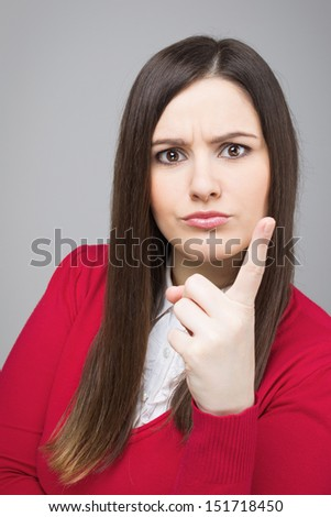 Mad businesswoman pointing with a finger  - stock photo