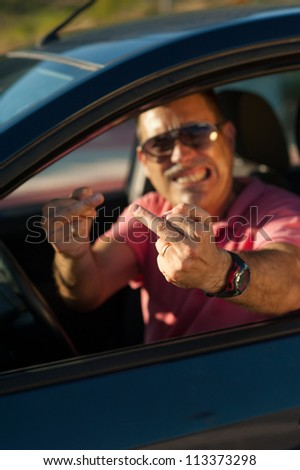 Mad driver in quite an aggressive behaviour - stock photo