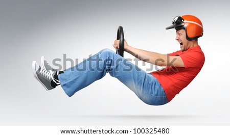 Mad man auto driver with steering wheel and helmet, concept racing - stock photo