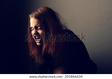 Mad possessed by a demon girl shouting - stock photo
