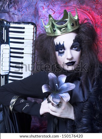 Mad queen. Youn woman wotn creative visage and in crown - stock photo