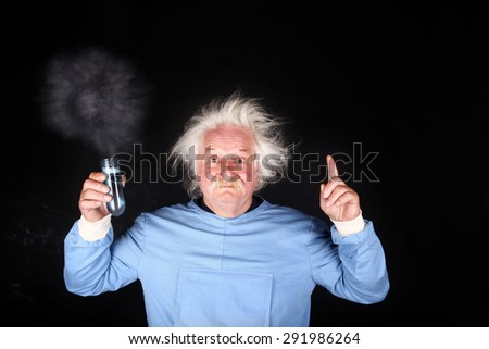 Mad scientist nutty professor is doing experiment - stock photo