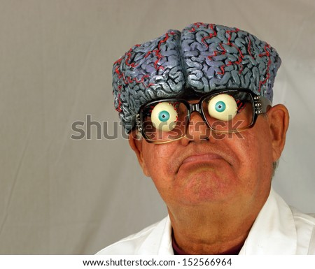 Mad scientist, with brain coming out of his head, makes a funny face as he ponders his problems. - stock photo