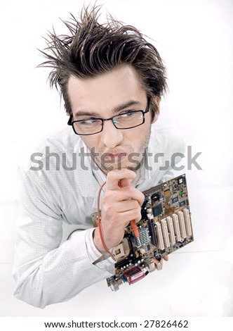 Mad technician repairing mainboard - stock photo