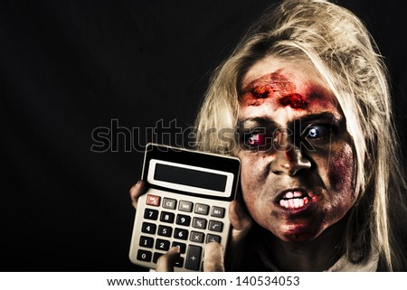 Mad undead business woman having financial difficulty pressing button on a recession calculator. Halloween sale
