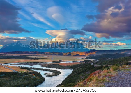 Mad wind over Patagonia. Striking clouds over the rocks  Los Kuernos and Valley Serrano - stock photo