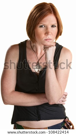 Mad young European woman with chin on fist - stock photo