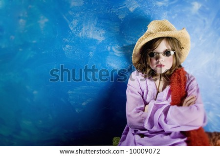 Mad Young Girl Wearing a Straw Cowboy Hat and Funny Sunglasses - stock photo