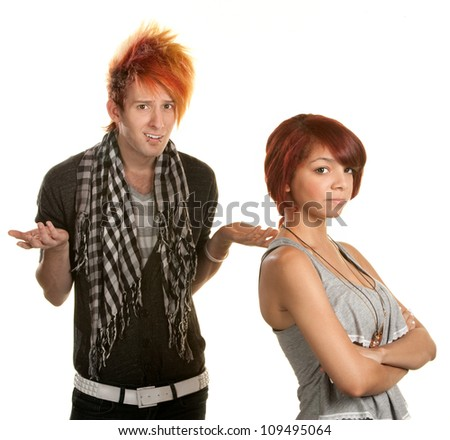 Mad young teenage couple over white background - stock photo