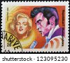 MADAGASCAR - CIRCA 1994: A stamp printed in Madagascar shows Marilyn Monroe and  Elvis Presley, circa 1994 - stock photo