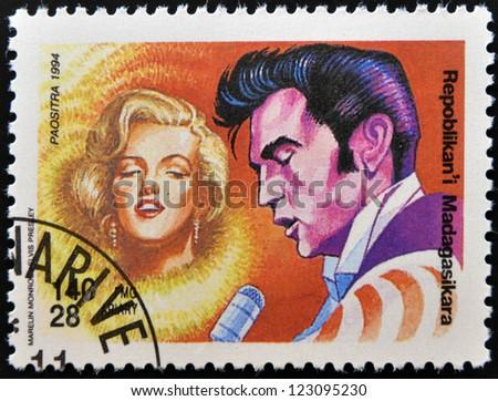MADAGASCAR - CIRCA 1994: A stamp printed in Madagascar shows Marilyn Monroe and  Elvis Presley, circa 1994 - stock photo